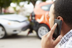 42310021 - male driver making phone call after traffic accident